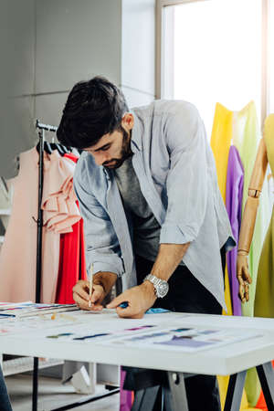 Creative Garment Design Tailoring Service Concept. Cute Professional Sewer Measuring Male Bearded Model Waist or Hip. Smiling Outfit Designer Taking Man Measurement for Formal Suit with Tape Meter Standard-Bild - 143289223