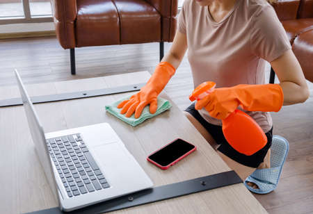 Women clean the house with clothes and liquid. To protect against viruses, Corona Covid-19 prevents the spread of the virus.