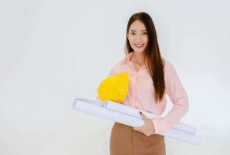 Female architect standing with a hat and working structure chart on a white ground