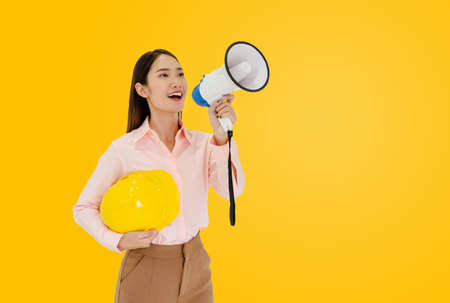 Female architect and megaphone On a yellow background There is space to fill the text.