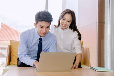 Concept corporate couple business people, handsome businessman Confident and employees Beautiful office woman Are present talking about a new financial company's project. professional teamwork.