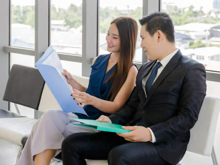Concept corporate couple business people, handsome businessman Confident and employees Beautiful office woman Are present talking about a new financial company's project. professional teamwork. Imagens