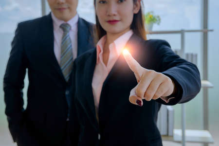 goal concept, confident smart, businesswoman working in a new office and boss. she used a technology smartphone, tablet, computer and relax at break time in a small financial company 免版税图像 - 153532572