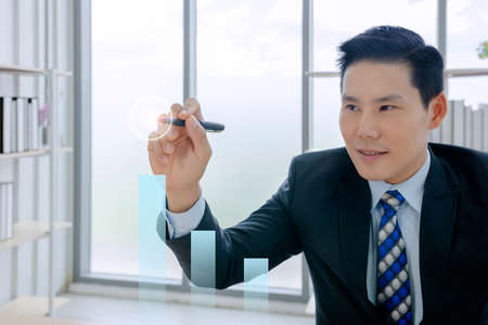 goal concept, confident smart, businessman working in a new office Is the boss. he used a technology smartphone, tablet, computer and relax at break time in a small financial company 免版税图像 - 153518044