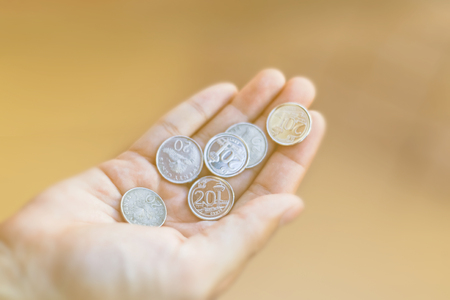 View of the Singapore dollar , The view of silver coins in Singapore at hand.