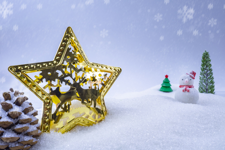 Christmas background with snowman, and falling snow, close-up. Stock Photo