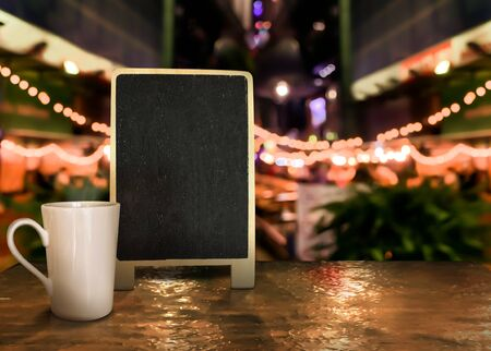 Backboard wood label with cup on the table with bokeh