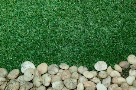Artificial grass and gravel. Stock Photo