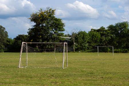 goalline: Old soccer goal in field Stock Photo
