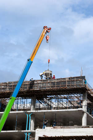 Construction site with crane and workers photo