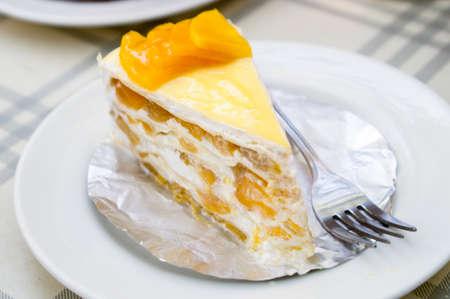 A piece of Mango Cheese Cake photo