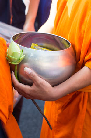 Offer food to monk on early morning Banco de Imagens