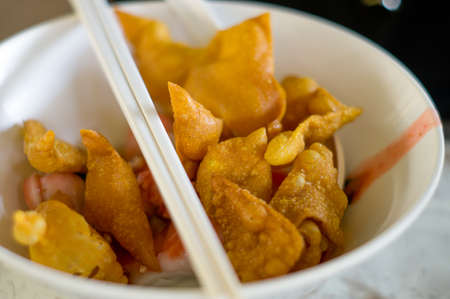Wonton fried sheet in a bowl of noodle photo
