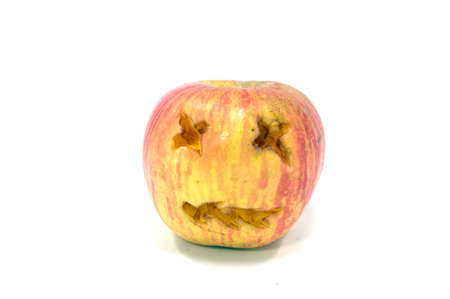 rot: Rot apple with face on white background