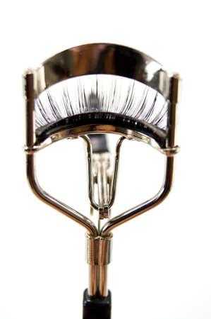 fake false eyelash with curler isolated 免版税图像