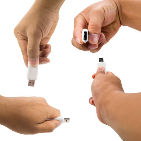 Overview of usb thumb drive in a hand on white background. photo