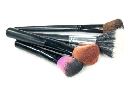Professional makeup brush set on white background photo
