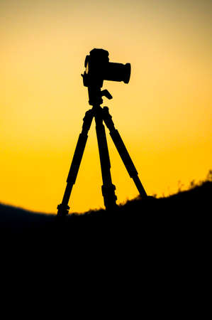Silhouette of a camera on tripod photo