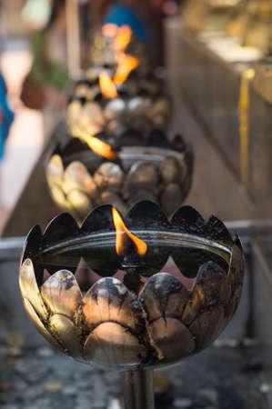 oil lamps lining for prayer at Doi suthep temple, chiangmai, thailand Stock Photo - 27076709