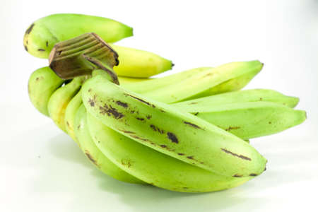 bruised: Bruised green banana on white background Stock Photo