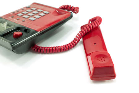 Red telephone receiver isolated on a white
