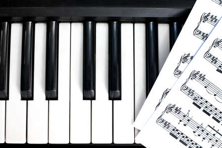 octave: background of piano keyboard with notes Stock Photo