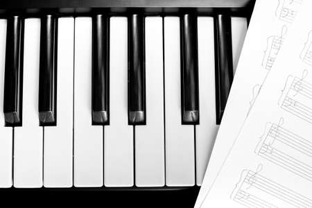 piano keyboard with notes photo