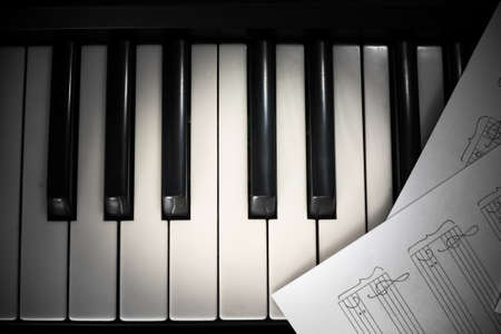 piano keyboard and notes with vignette photo