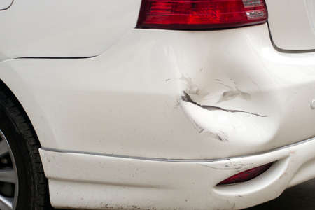 White dented car, broken car 스톡 콘텐츠