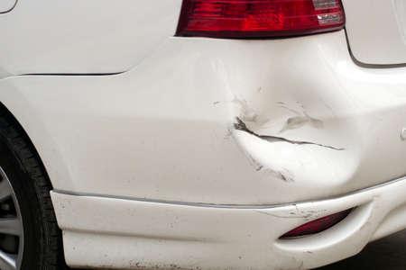 White dented car, broken car Standard-Bild