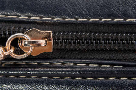 Closeup zip with leather bag photo