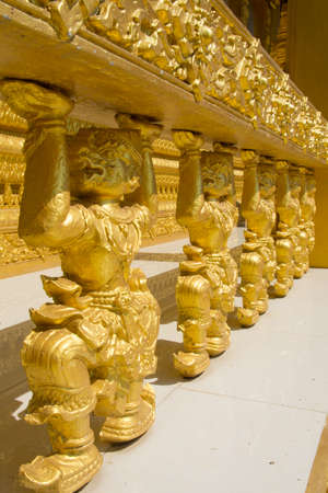 chachoengsao: Hanuman statue golden around temple wall. Chachoengsao province, Thailand Stock Photo