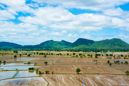 View of mountains and sky. Near the farmland The rainy season. Preparing for planting It is a beautiful landscape. Located in Kanchanaburi province, Thailand.