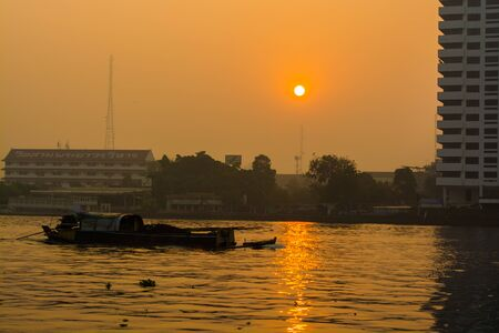 A boat is running in a river and morning atmosphere ,Location Chao Pha Ya river  Bangkok  Thailand. Stock Photo