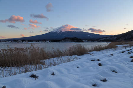 This photo was shot from Oishi Park, Kawaguchigo Lake. The snow falls in winter and makes this area cover by the beutiful white color.Mount Fuji Fujisan is with 3776 meters Japan's highest mountain. It is not surprising that the nearly perfectly shaped volcano has been worshiped as a sacred mountain and experienced big popularity among artists and common people throughout the centuries.Mount Fuji is an active volcano, which most recently erupted in 1708. It stands on the border between Yamanashi and Shizuoka Prefectures and can be seen from Tokyo and Yokohama on clear days.