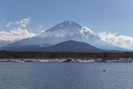 This photo was shot from Shoji Lake which is one of five lake surrounding Mt.Fuji. The snow falls in winter and makes this area cover by the beutiful white color.Mount Fuji Fujisan is with 3776 meters