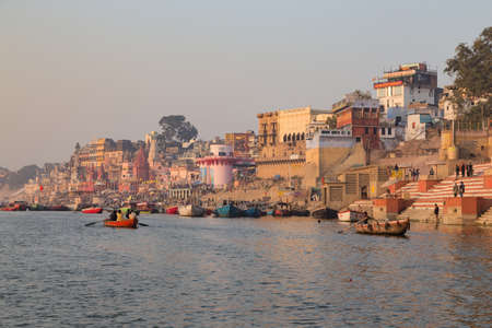 This photo was shot from Varanasi, India in the morning. The soft sun light touch the old building along the ganga river. Varanasi is a North Indian city on the banks of the Ganges in Uttar Pradesh. It is one of the oldest continuously inhabited cities in