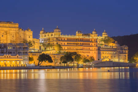 This photo was shot from Udaipur city at twilight time. Udaipur city palace was built over a period of nearly 400 years being contributed by several kings of the dynasty. It is located on the east bank of the Lake Pichola and has several palaces built wit Editorial