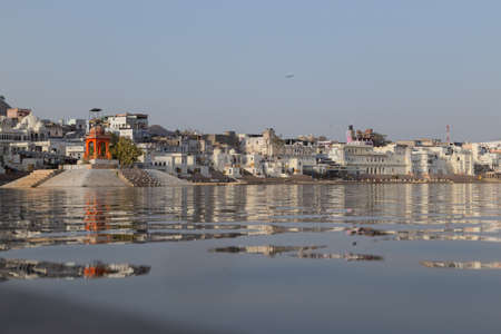Pushkar is a city in the Ajmer district in Rajasthan, India. It is one of the five sacred dhams for devout Hindus. It is one of the oldest existing cities of India. It lies on the shore of Pushkar Lake. The date of its actual origin is not known, but legend associates Brahma with its creation. Foto de archivo