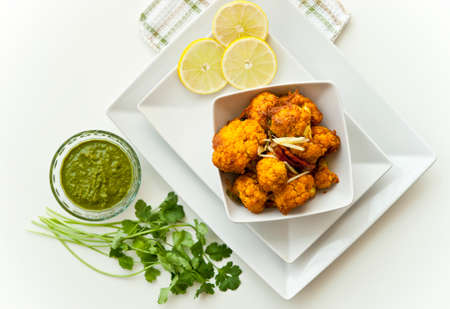 vegetarian cuisine: Cauliflower cooked In Indian style