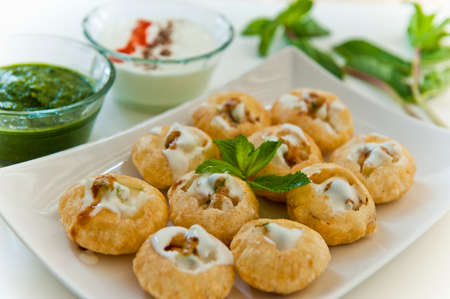 pani: Pani puri  golgappe served with yogurt