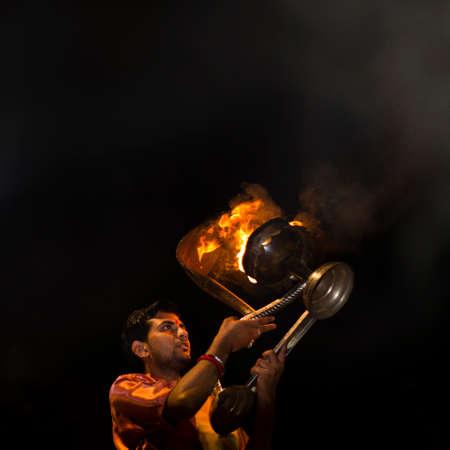 december 25th: Varanasi, India - 25th December 2015 : Man performing rituals during Ganga Aarti.