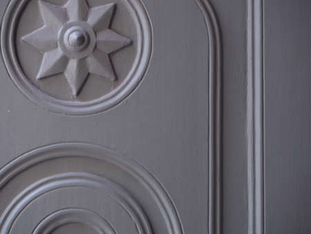 gray wooden door in a beautiful patterned tample