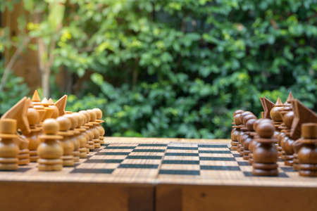 wooden chess board with wooden chess pieces Foto de archivo