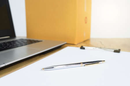 a laptop and contract. Ideas about finance 版權商用圖片