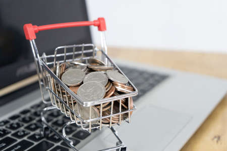 Coin in a trolley on a laptop keyboard. Ideas about online shopping, online shopping is a form of electronic commerce that allows consumers to directly buy goods from a seller over the internet.