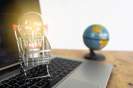 Light bulb in a trolley on a laptop keyboard and Globe. Ideas about good ideas online shopping, online shopping is a form of electronic commerce that allows consumers to directly buy goods from a seller over the internet.