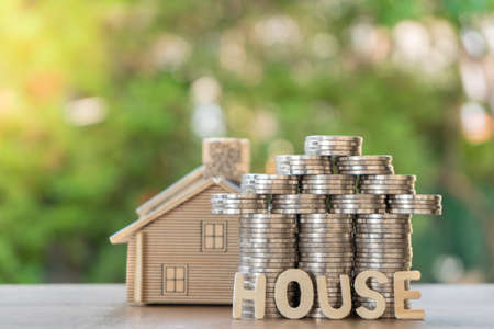 Set money Coin, shaped like a house ,house model, and house text. With green background, financial concept