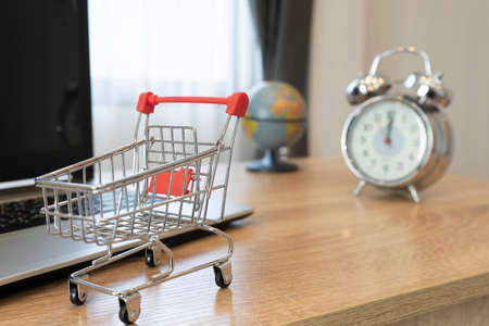 Online shopping concept. Shopping cart, on laptop