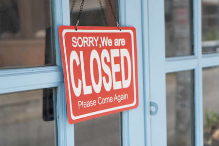 A Sign board of sorry we are closed of business shop with Blue door 版權商用圖片